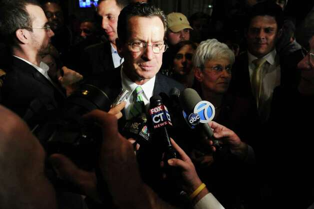 Democratic gubernatorial candidate Dan Malloy answers questions from the media at The Society Room early this morning.  Malloy was declared the winner of the governor's race by Secretary of State Susan Bysiewicz in Hartford, Conn. on Wednesday November 3, 2010. Photo: Kathleen O'Rourke / Stamford Advocate