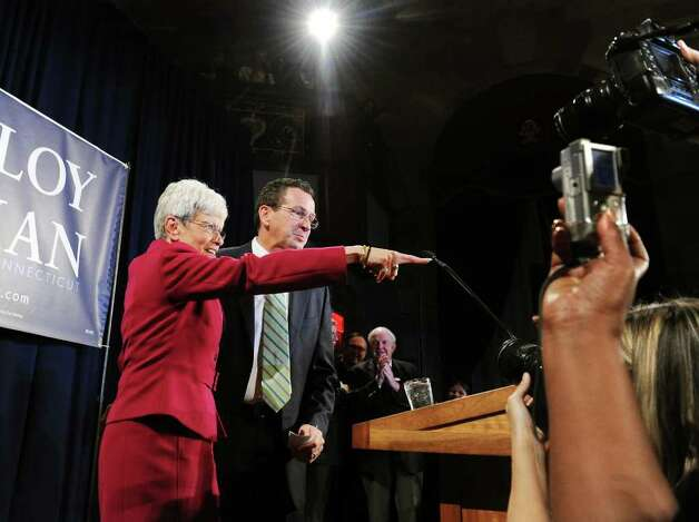 Democratic gubernatorial candidate Dan Malloy and lieutenant governor candidate Nancy Wyman addresse their supporters at The Society Room in the early hours on Wednesday November 3.   Malloy was declared the winner of the governor's race by Secretary of State Susan Bysiewicz in Hartford, Conn. on Wednesday November 3, 2010. Photo: Kathleen O'Rourke / Stamford Advocate