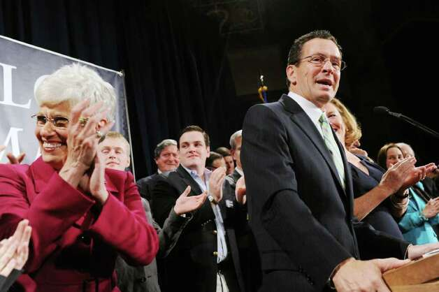 Democratic gubernatorial candidate Dan Malloy addresses his supporters with his wife Cathy Malloy and lieutenant governor candidate Nancy Wyman at his side at The Society Room in the early hours on Wednesday November 3.   Malloy was declared the winner of the governor's race by Secretary of State Susan Bysiewicz in Hartford, Conn. on Wednesday November 3, 2010. Photo: Kathleen O'Rourke / Stamford Advocate
