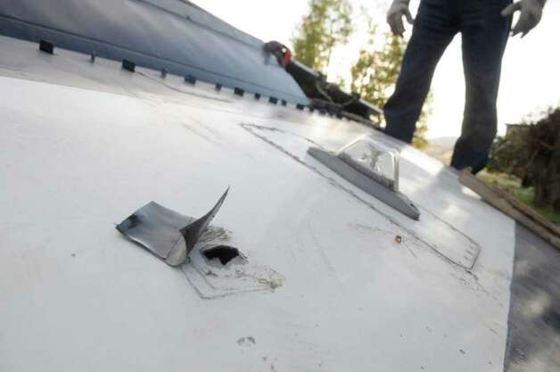 A bullet hole is seen in the wing of a OV-10D Bronco warplane  Wednesday at Questar III Rensselaer Educational Center in Troy. The OV-10D Bronco  was donated to the school, which will use the plane in the aviation mechanics education program the school is starting up.  (Paul Buckowski / Times Union) Photo: Paul Buckowski / 00010913A