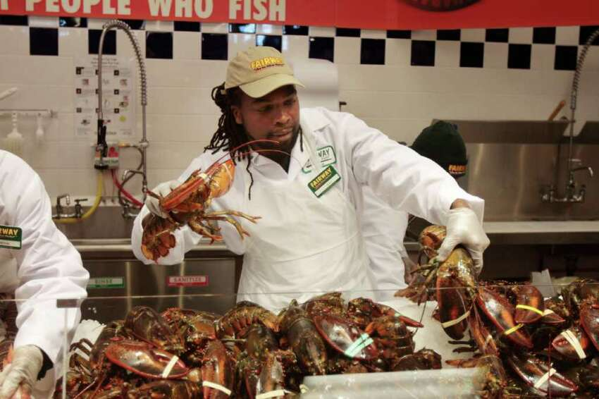 Ray Roe, of Stamford, wrangles live lobsters on opening day of Fairway Market in Stamford, Conn. on Wednesday November 3, 2010.