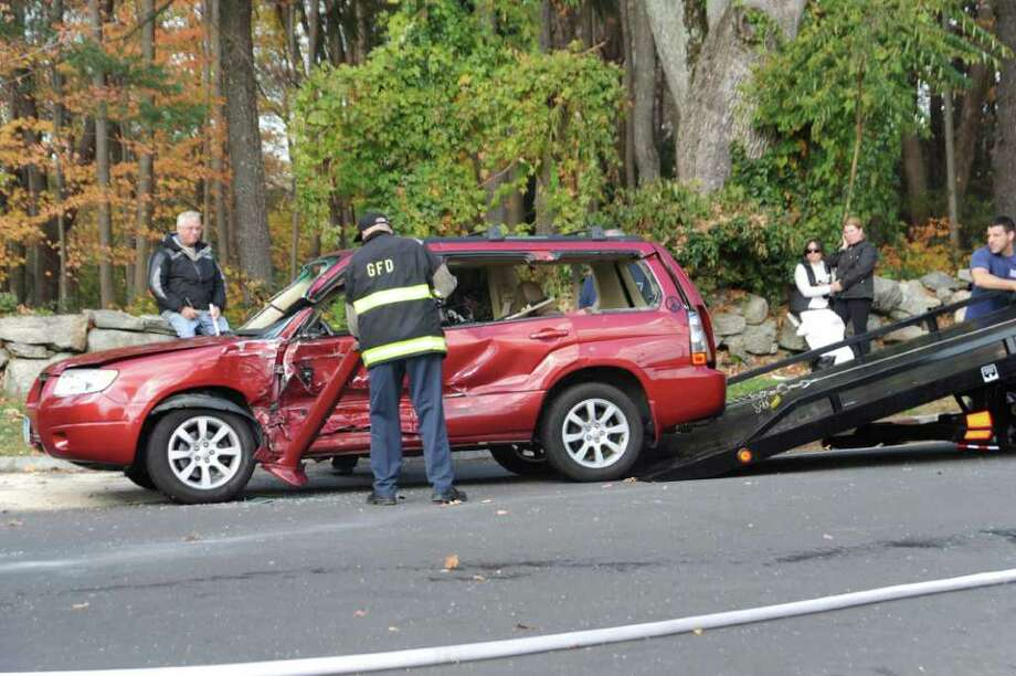 The accident on Round Hill Road, on Wednesday, Nov. 4, 2010. Photo: Helen Neafsey / Greenwich Time