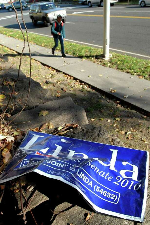 """A knocked-down """"Linda McMahon for U.S. Senate 2010"""" sign on the northern side of East Putnam Avenue, Greenwich, Wednesday afternoon, Nov. 3, 2010. Photo: Bob Luckey / Greenwich Time"""