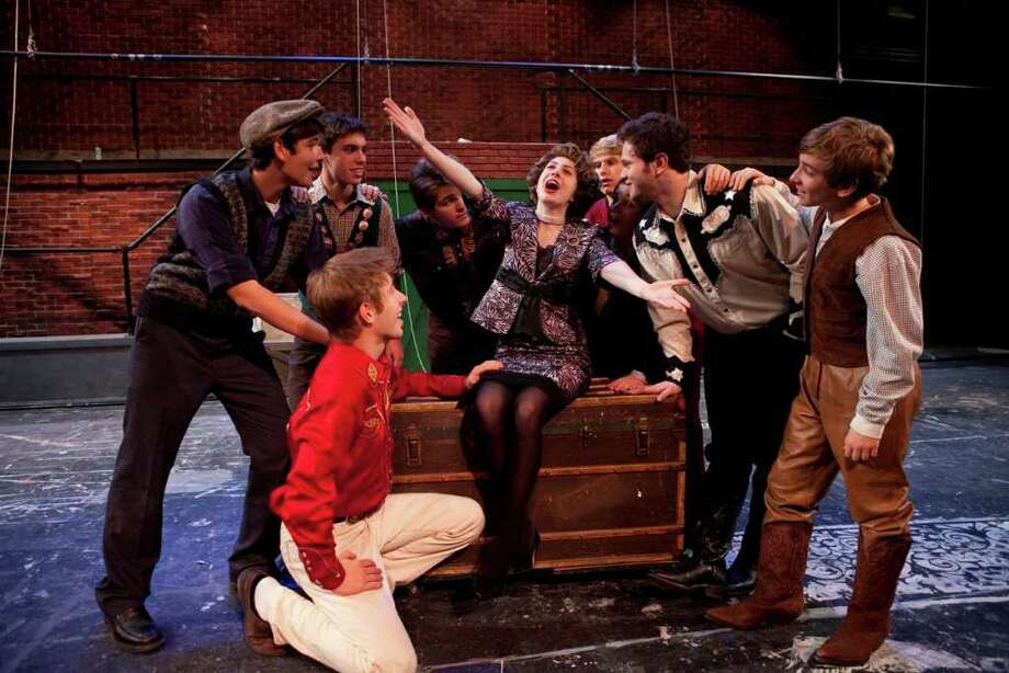 "Gearing up for its upcoming production of Curtains, Staples Players' Eva Hendricks, class of '11, as Carmen Bernstein rehearses ""It's a Business"" with, from left, Charlie Greenwald, Clay Singer, Michael Findley, Elliott Enriquez, Michael Sixsmith, Ryan Shea, Matt Grenberg and Will Haskell. Photo: Contributed Photo / Westport News contributed"