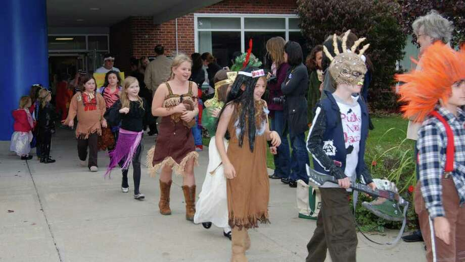 South School students start their lap around the school during their annual Halloween Parade. From front, are Liam O'Neill, Holden Hobbs, Bexi Ainsworth, Maddie Sturcke, Lauren Ozimek and Anna Reed. Photo: Jeanna Petersen Shepard / New Canaan News