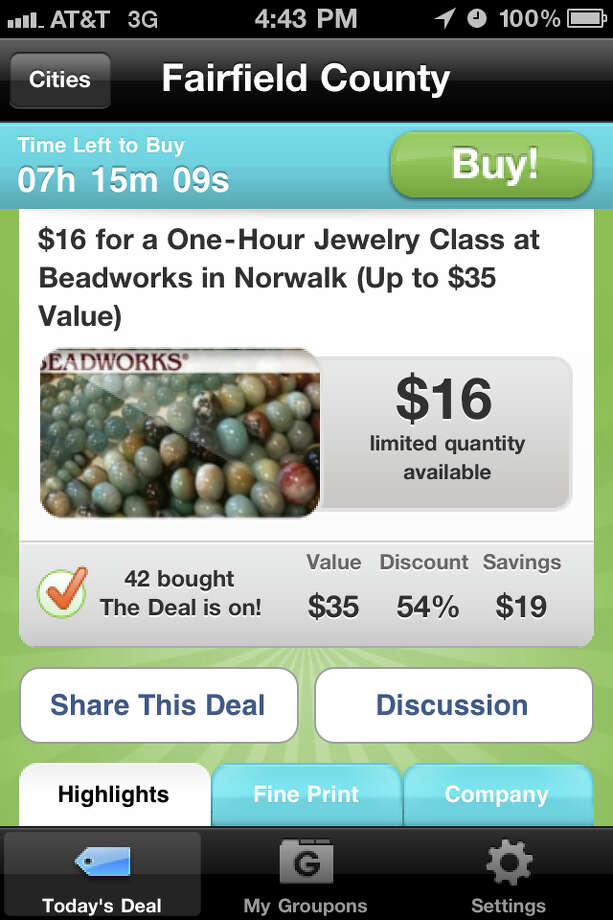 Groupon has entered the Fairfield County scene by offering daily deals at area businesses, via its website, www.groupon.com, through a multitude of social networking sites, and an application availabe on the iPhone, shown here. Photo: Gary Jeanfaivre / Fairfield Citizen