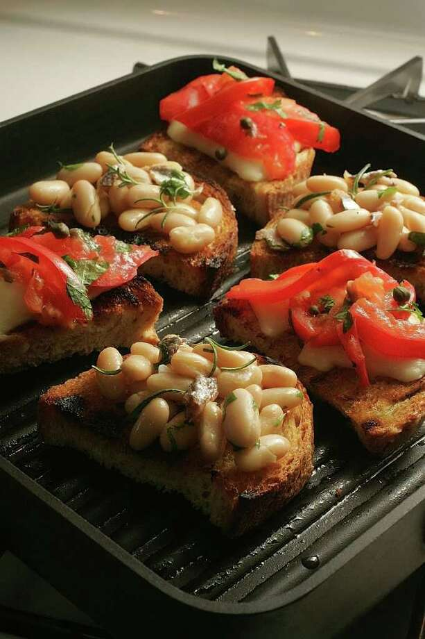 Hundreds of hors d'oeuvres can be made ahead of time, including white-bean bruschetta. (Raul Rubiera / Miami Herald) Photo: RAUL RUBIERA / MIAMI HERALD