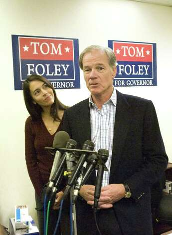 Republican Tom Foley, with his wife Leslie Fahrenkopf Foley, addresses the press regarding the race for governor in his headquarters on Summer Street in Stamford, Conn., November 3, 2010. Secretary of State Susan Bysiewicz called Democrat Dan Malloy winner of the race by 3,000 votes. Foley says both his camp and the Associated Press have different figures totaling less than 2,000. He wants access to the Secretay of State's numbers to reconcile the difference. Photo: Keelin Daly / Stamford Advocate