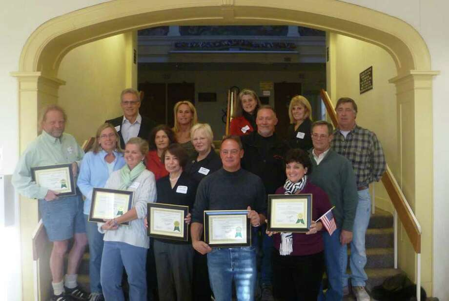 """Winners of Westport's Beautification Awards pose in town hall. The winners were the Westport Garden Club """"Beach Buds,"""" Sterling Investment Partners, Imperial Avenue Holdings LLC, the Westport Woman's Club and Kowalsky Brothers Inc. Photo: Tom Cleary / Westport News"""