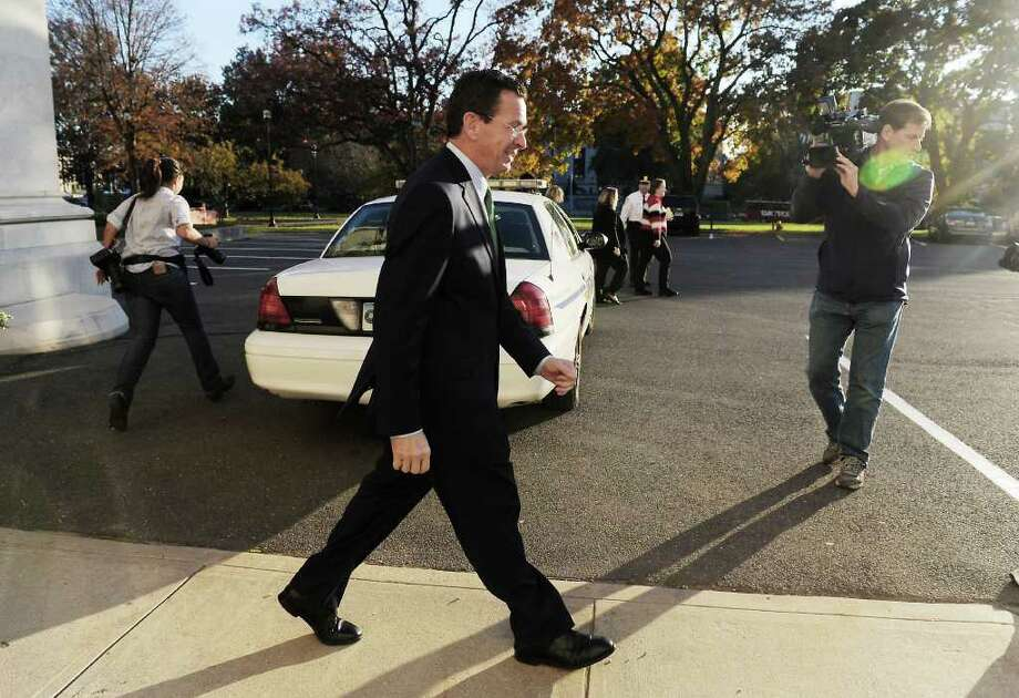 Democratic candidate Dan Malloy leaves the State Capitol after addressing the media in the Old Judiciary Committee Room in Hartford, Conn. on Tuesday November 2, 2010.  Malloy has been declared the winner in the gubernatorial race by Secretary of State Susan Bysiewicz. Photo: Kathleen O'Rourke / Stamford Advocate