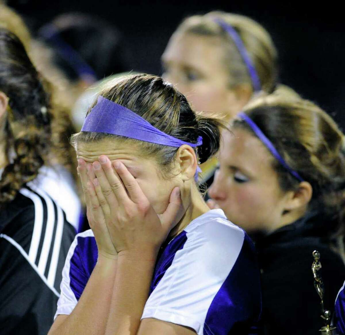 A Westhill player buries her head in her hands during the 2010 Girls FCIAC Soccer Championship between Greenwich High School vs. Westhill High School at Norwalk High School, Wednesday night, Nov. 3, 2010. Greenwich defeated Westhill, 1-0.