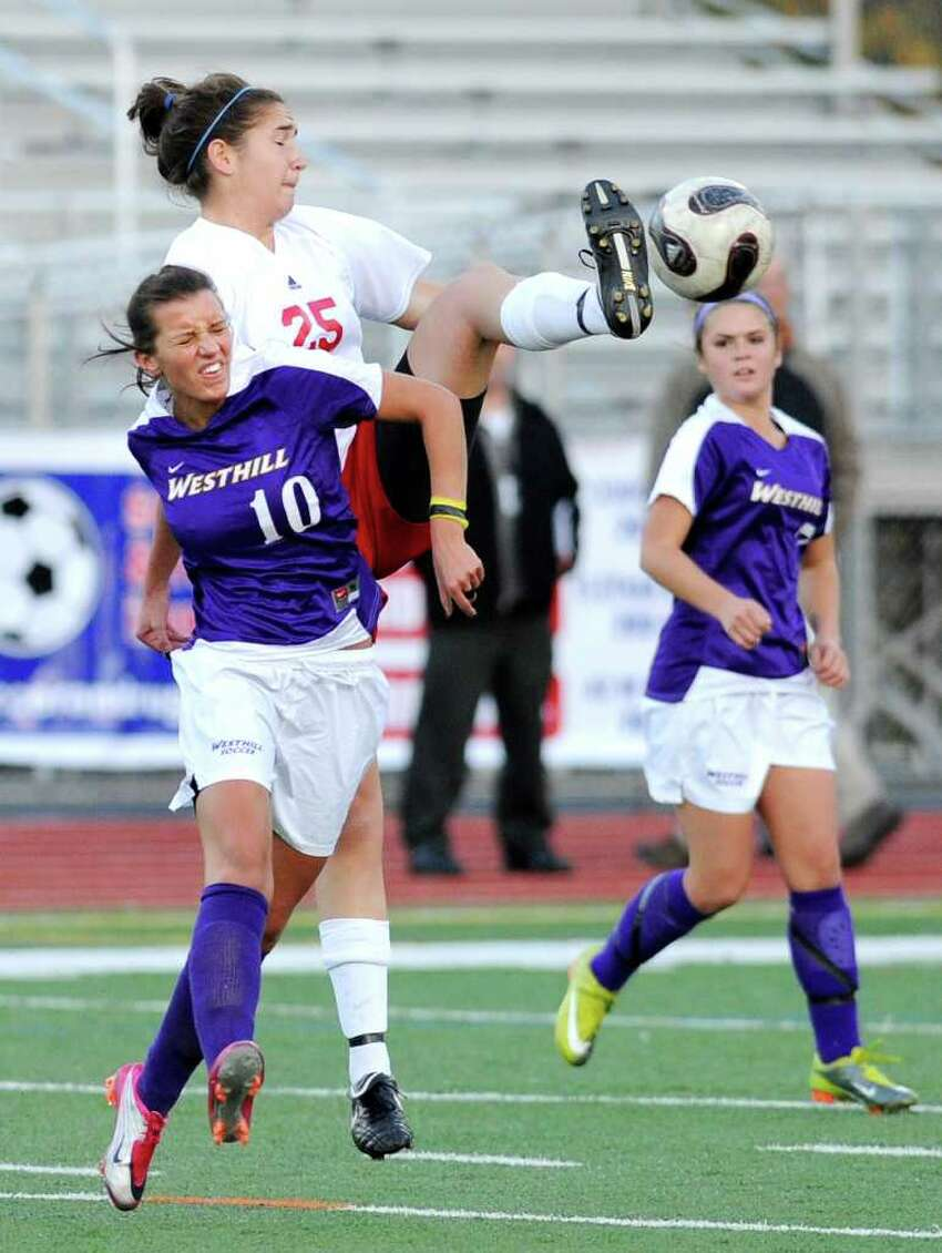 Aulona Veja, # 10 of Westhill, left, goes up against a high-kicking Sara Rosenband, # 25 of GHS, top, during the 2010 Girls FCIAC Soccer Championship between Greenwich High School vs. Westhill High School at Norwalk High School, Wednesday night, Nov. 3, 2010. Greenwich defeated Westhill, 1-0.