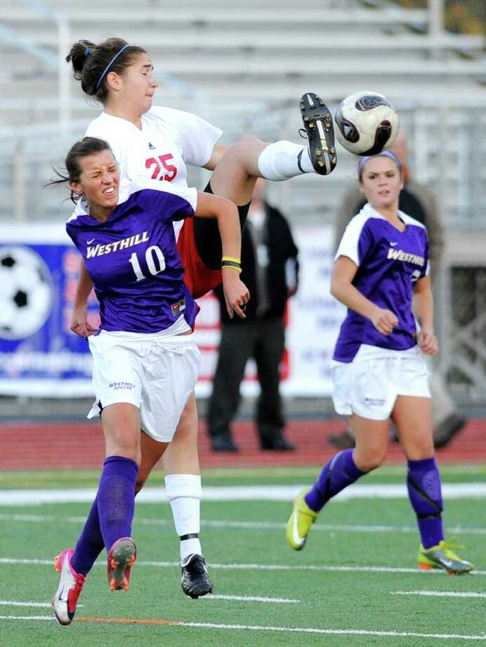 Aulona Veja, # 10 of Westhill, left,  goes up against a high-kicking Sara Rosenband, # 25 of GHS, top,  during the 2010 Girls FCIAC Soccer Championship between Greenwich High School vs. Westhill High School at Norwalk High School, Wednesday night, Nov. 3, 2010.  Greenwich defeated Westhill, 1-0. Photo: Bob Luckey, ST / Greenwich Time