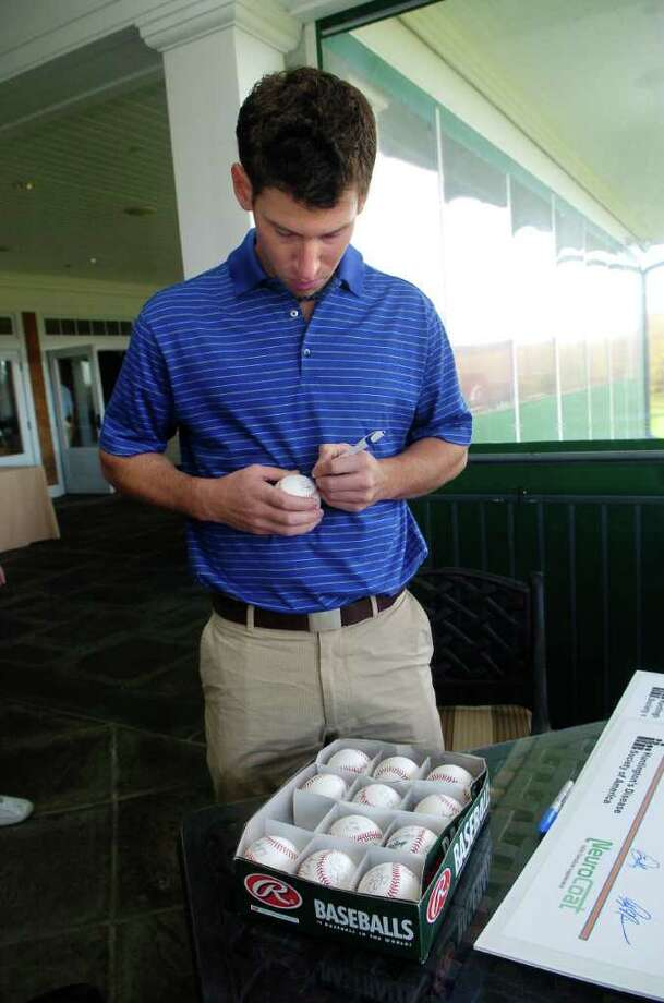 Craig Breslow signs baseballs at the annual Tim Teufel Charity Golf tournament at Tamarack Country Club in Greenwich, Conn. on Thursday October 28, 2010. Photo: Dru Nadler / Stamford Advocate Freelance