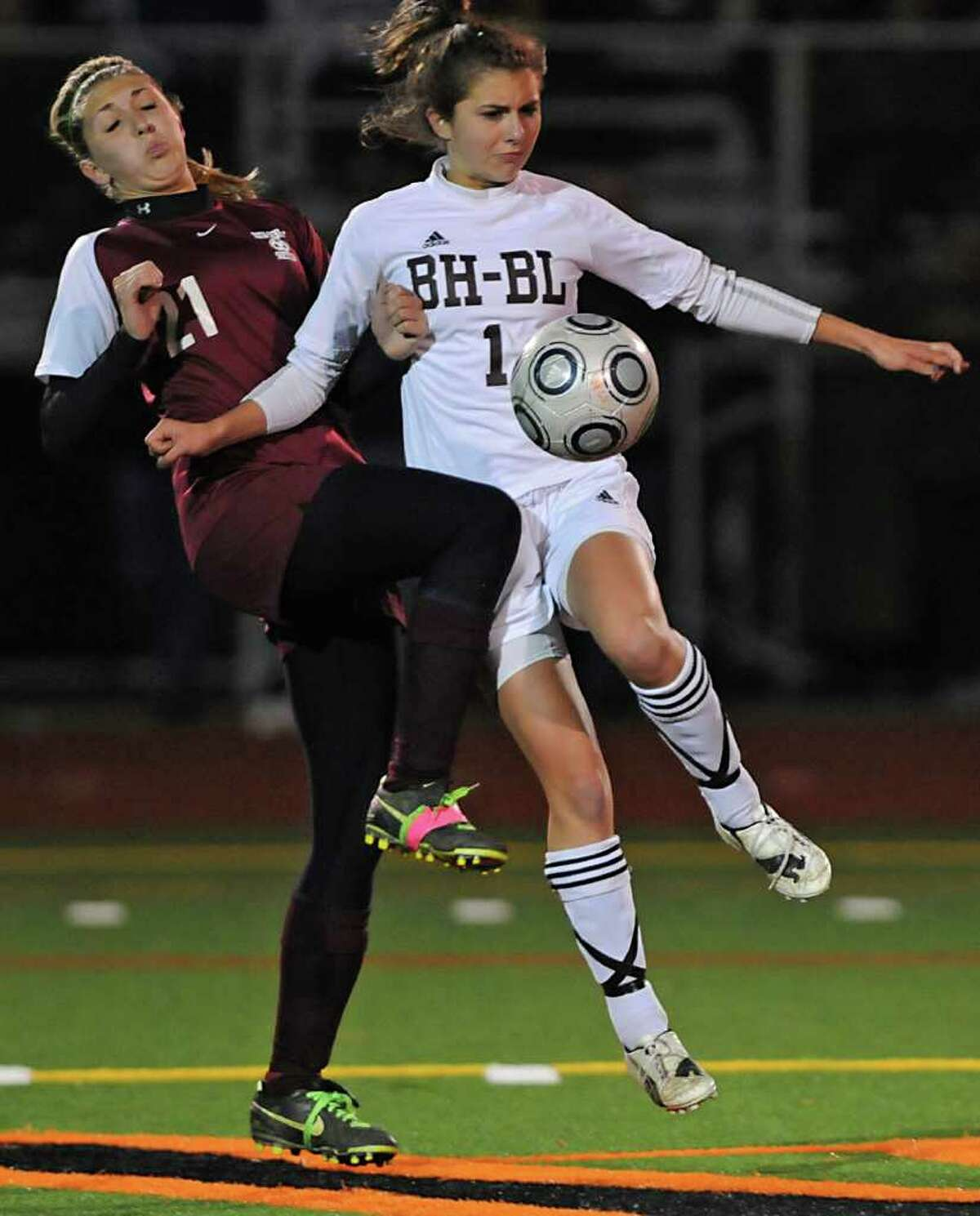 High school soccer -- Jess Presti of Scotia, left, battles for the ball with Bryony Striffler of Burnt Hills. (Lori Van Buren / Times Union)