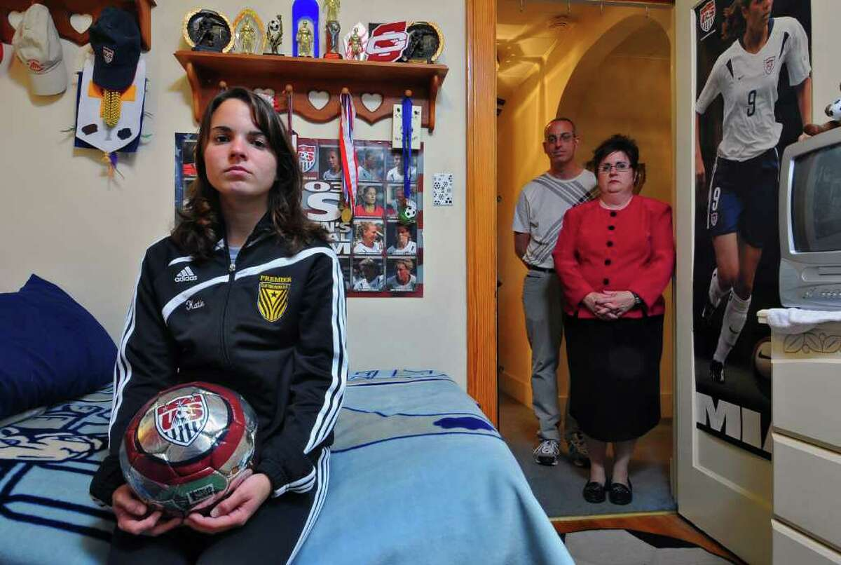 Katlyn Brown, a Scotia-Glenville senior, just quit her school soccer team after years of bullying by her teammates. In January, a student who has since graduated attacked her during her premier league soccer game. She was photographed with her parents Jerry and Sherry, in their Scotia, NY home on Thursday evening October 14, 2010. ( Philip Kamrass / Times Union )