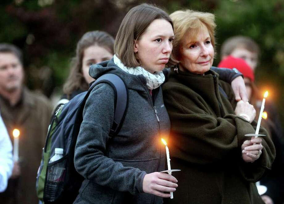 Shawne Lomauro, left, and Joan Grant listen during a candlelight vigil for acceptance at Fairfield University's Chapel Plaza on Wednesday, November 3, 2010. Photo: Lindsay Niegelberg / Connecticut Post