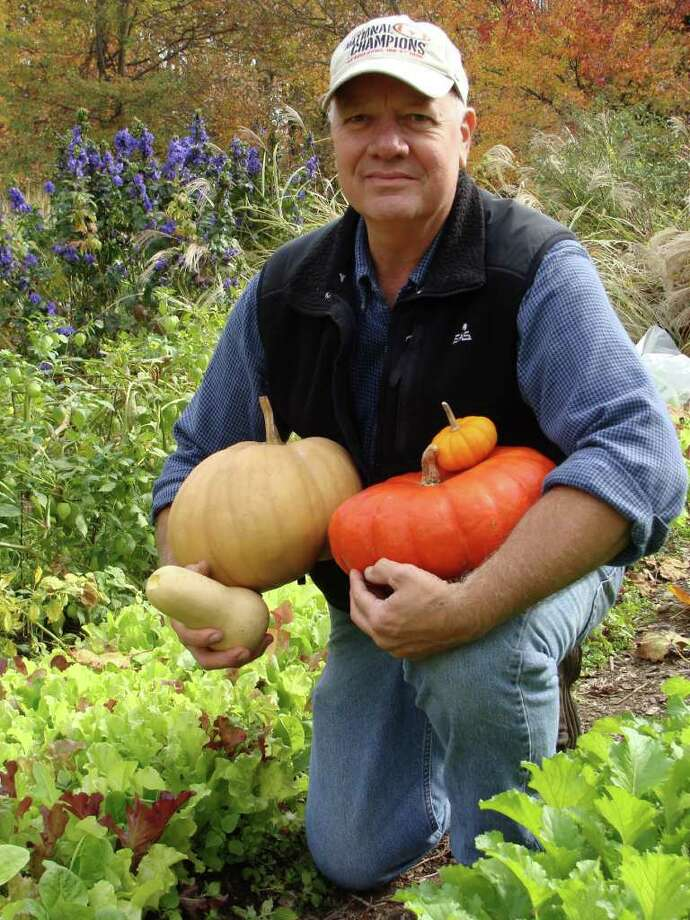 Eric Friske, who helps manage Fairfield's community gardens in Drew Park, shows off some of the pumpkins and gourds harvested this fall from the public plots. Photo: Meg Barone / Fairfield Citizen freelance