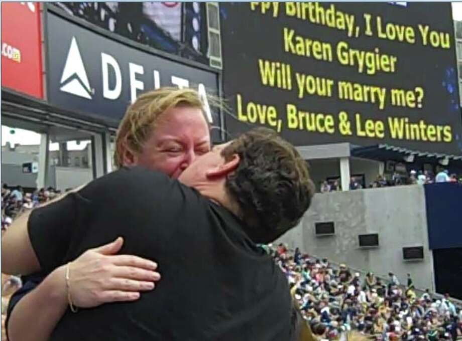 Bruce Winters of Redding proposed to Karen Grygier of Chicago at Yankee Stadium this past spring. The Yankees were playing Chicago on Karen's birthday, and some friends had flown in to visit - they all ended up at the game. Bruce's son, Lee, helped Bruce plan his proposal. Photo: Contributed Photo / The News-Times Contributed