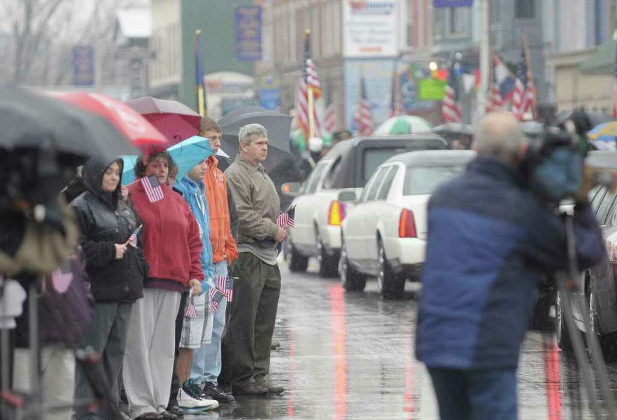 Members of the community of St. Johnsville line Main Street to pay their respects to Army Pfc. David Jones Jr., as the hearse carrying his body from Griffiss International Airport drives through town on Thursday, Nov. 4, 2010. Jones died from a gunshot wound Oct. 24 in Baghdad, Iraq. (Paul Buckowski / Times Union)