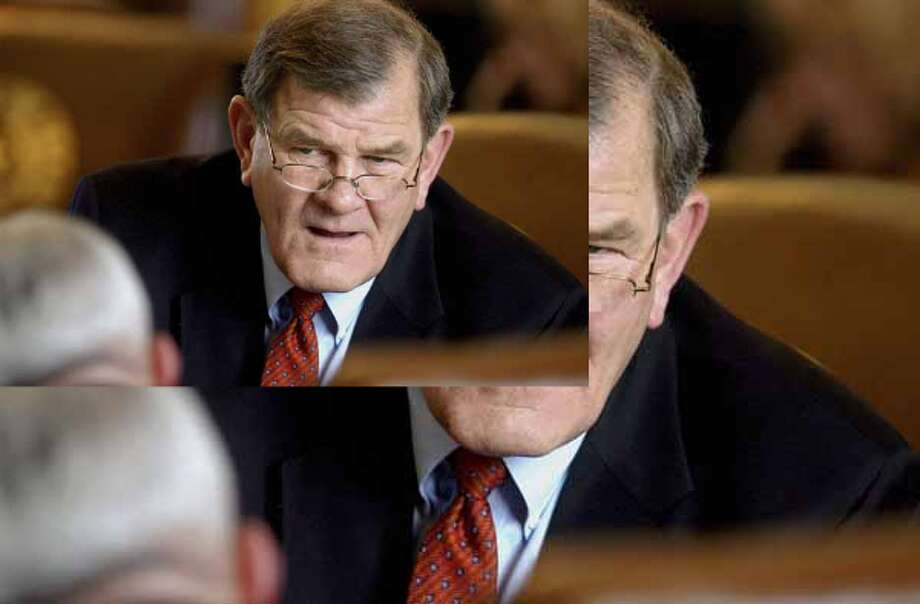 Rep. Edmund Kuempel (R-Seguin) considers a point being taken by a fellow lawmaker on the floor of the House in Austin in 2005.