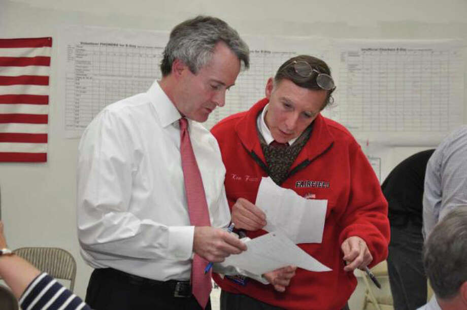 Tom Drew, the Democrat incumbent in the 132nd District, looks at results with Fairfield First Selectman Ken Flatto at the Fairfield Democratic Headquarters on Tuesday, Nov. 2, 2010. Photo: Amy Mortensen / Fairfield Citizen freelance