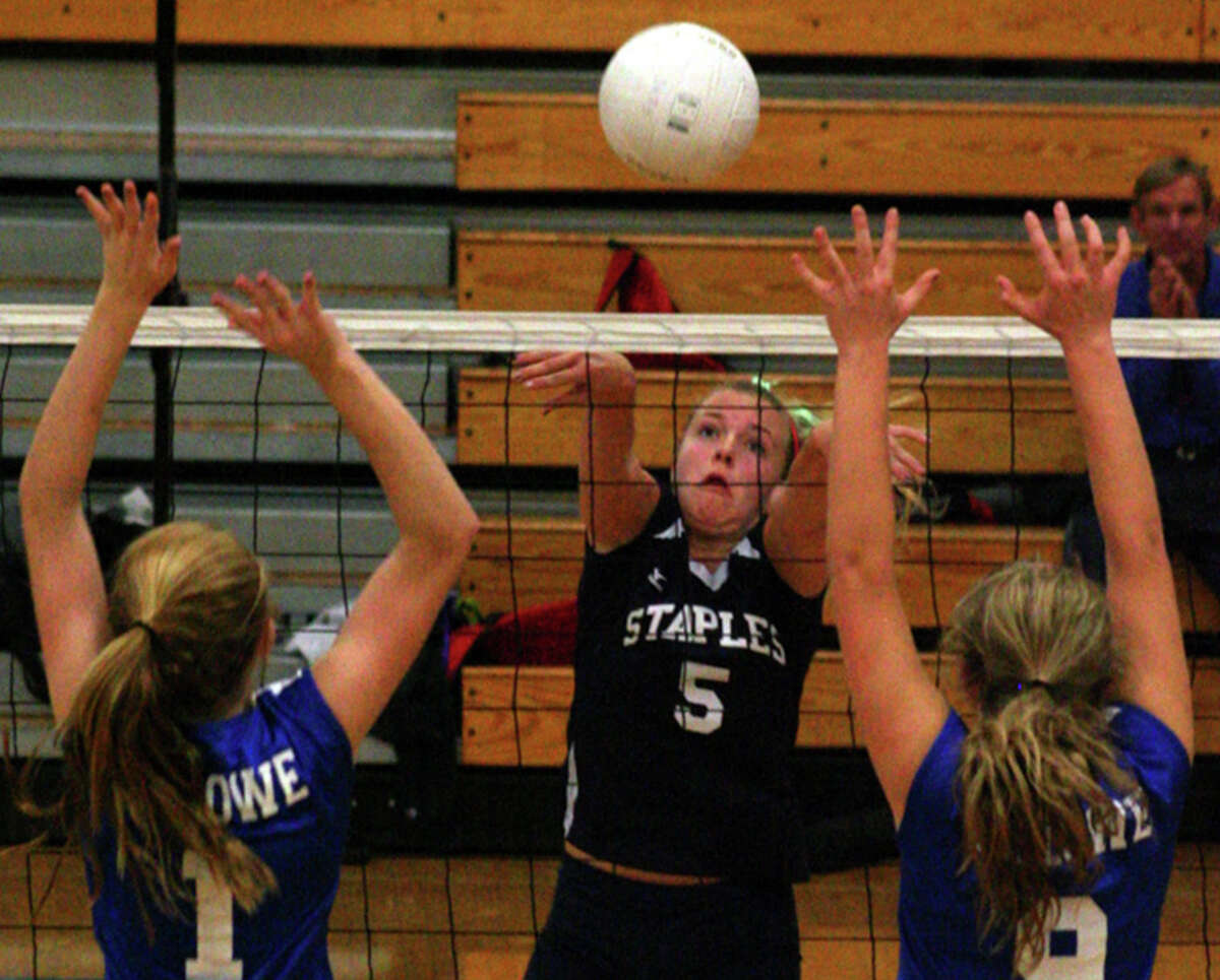 Staples junior Anna Link attempts a kill against Fairfield Ludlowe with a basketball pass in the FCIAC playoffs on Tuesday. Link had 13 digs in a 3-1 loss to Ludlowe.