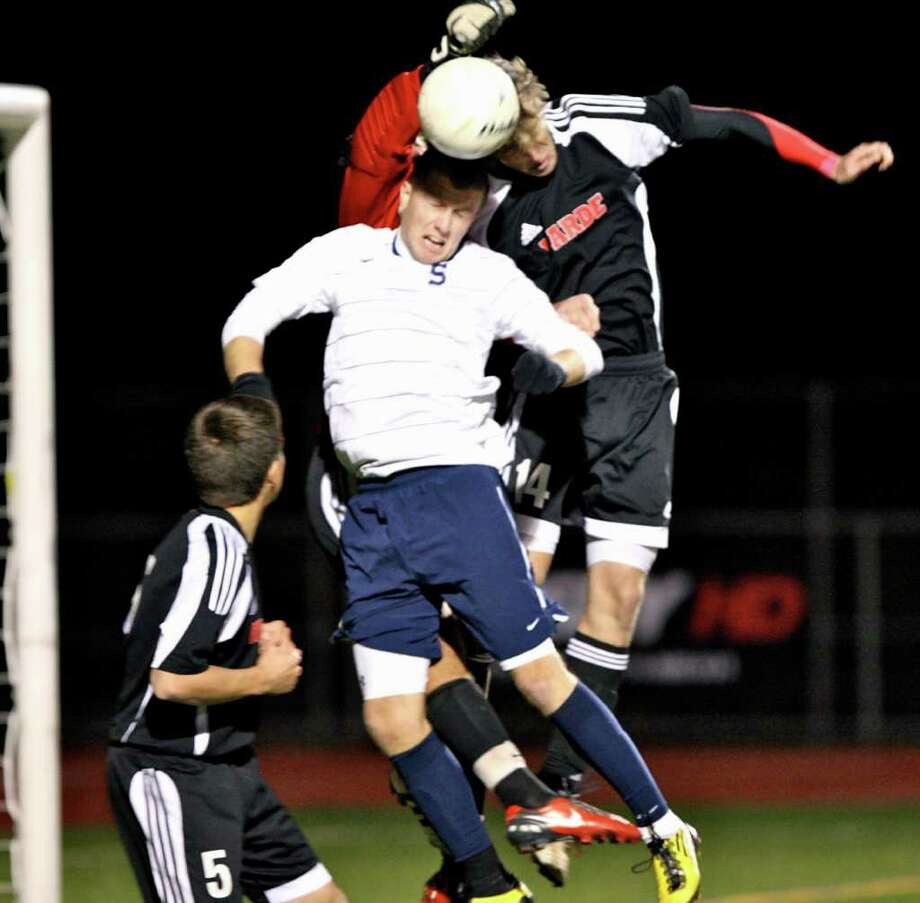 Staples senior tri-captain Brendan Lesch uses his head in a 2-1 victory over Fairfield Warde in the FCIAC finals on Wednesday. Lesch was the FCIAC tournament MVP. Photo: Contributed Photo / Carl McNair