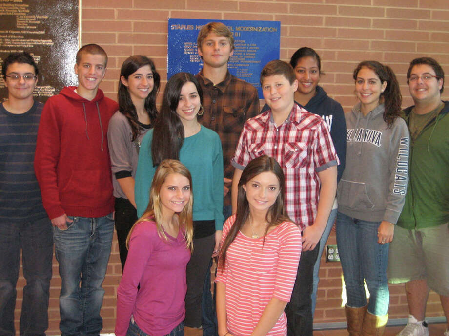 "These 11 Staples High School students were among 13 recently honored as ""Students of the Month."" The recognition program is designed to recognize those who might not otherwise receive personal recognition throughout their high school career. Back row, from left, are Michael Cozzi, Matthew George, Remy Bonett, Jackson Moss, Amereen Anand, Pangiota Tsilfides and Joshua Litvinoff. Middle row, from left, are Jamie Yarmoff and Joshua Rosenberg. Front row, from left, are Juliana Larnetta and Adrian Allen. Photo: Picasa 3.0;Kirk Lang, Kirk Lang / Fairfield Citizen"