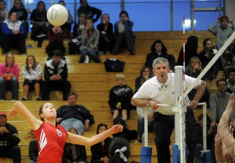 Kelsey Goodwin hits the ball over the net during Thursday's FCIAC volleyball semifinal game against Fairfield Ludlowe on the Falcons' home court on November 4, 2010. Photo: Lindsay Niegelberg / Connecticut Post