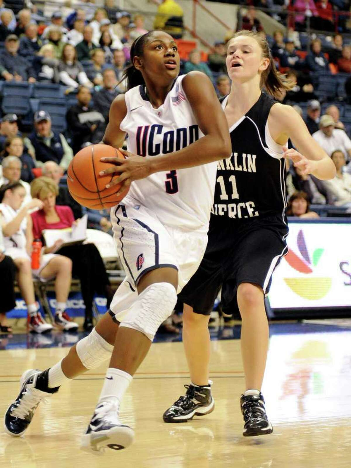 Connecticut's Tiffany Hayes, left, drives past Franklin Pierce's Brooke Coderre during the second half of their exhibition NCAA women's college basketball game in Storrs, Conn., on Thursday, Nov. 4, 2010. Hayes scored a game-high 25 points in her team's 112-41 victory. (AP Photo/Fred Beckham)