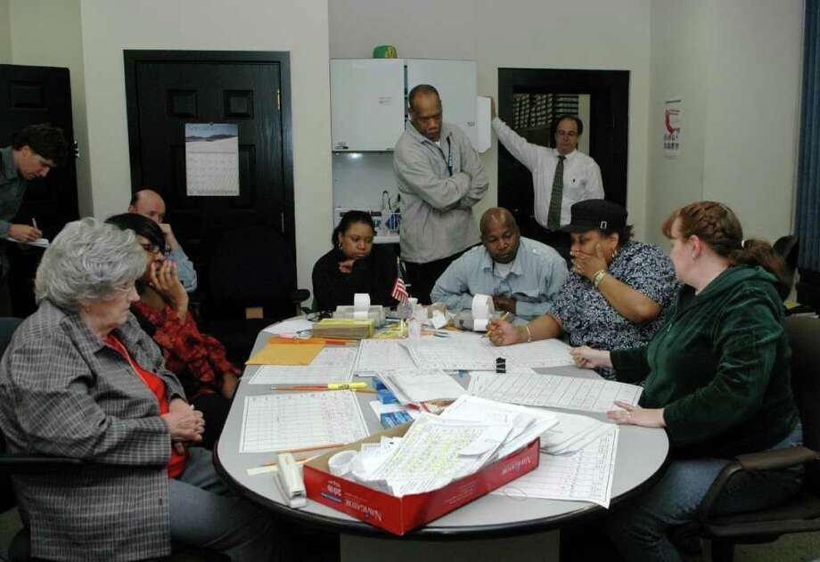 As of 7 a.m. Friday, November 5, 2010, -- 59 hours after Bridgeport's election polls were supposed to have closed -- the team of vote counters were still adding up tallies in the Registrar of Voters office in McLevy Hall. Photo: Cathy Zuraw / Connecticut Post