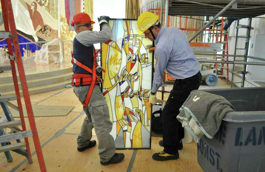 Workers from Italy prepare to install one of the new stained-glass windows at the Chapel of the Holy Spirit on the campus of Sacred Heart University in October. Photo: Contributed Photo / Fairfield Citizen contributed