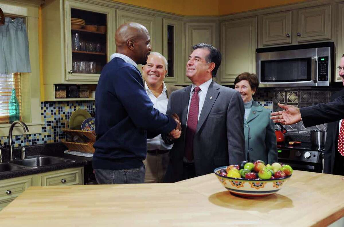 Terry Crews, former NFL player and actor, tours the set of TBS's sitcom 'Are We There Yet' with Stamford Mayor Michael Pavia, Lieutenant Governor Michael Fedele and State Representative Livvy Floren at the CT Film Center Stages in Stamford, Conn. on Friday November 5, 2010. Crewes plays Nick, new husband and stepfather, on the show.