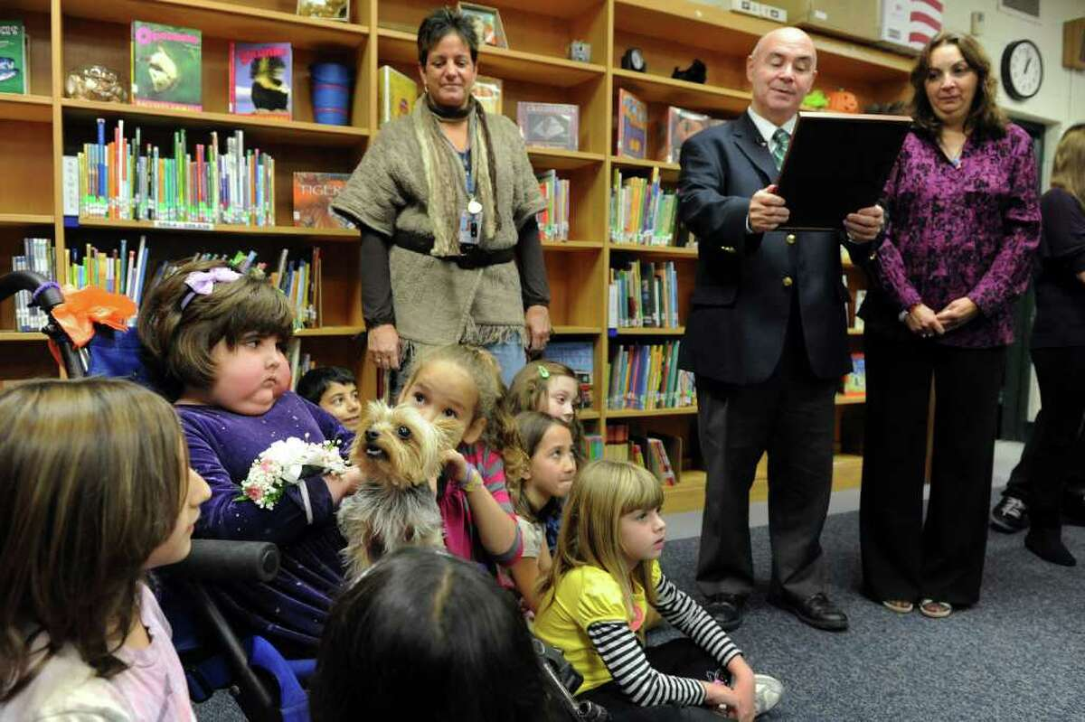 Mayor Jim Richetelli reads a proclamation declaring Friday, Nov. 5th, 2010 as Zoe Anyan Day in the City of Milford, Conn. in honor of the Live Oaks School 2nd grader who is battling brain cancer.
