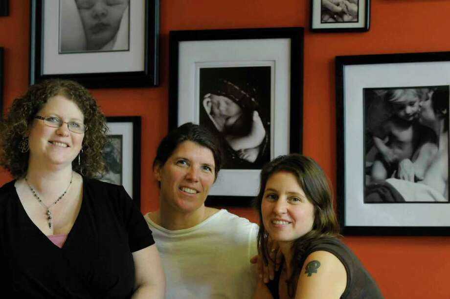 Doulas are a person who is professionally trained to assist a woman during childbirth and who may provide support to the family after the baby is born. From left are Jennifer Fegan-Szalay, Heidi Ricks and Maureen Murphy of Three Sisters at their office in Troy Wednesday 10/27/2010. (Michael P. Farrell / Times Union) Photo: Michael P. Farrell