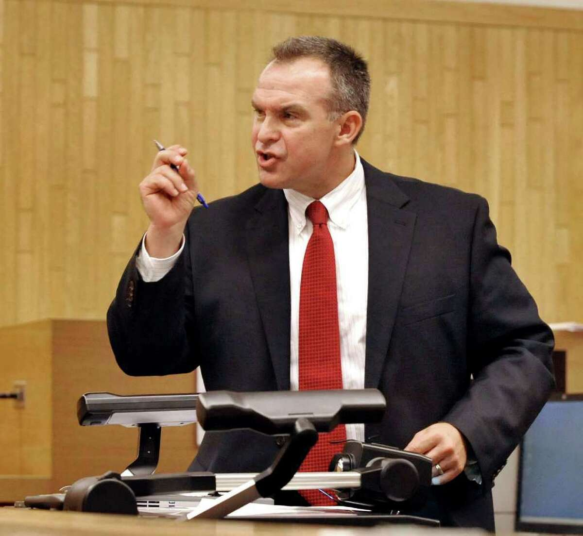 State's Attorney Stephen Sedensky makes his opening statement at Danbury Superior Court in the murder trial of Marash Gojcaj, Wednesday, Sept. 29, 2010 file photo.