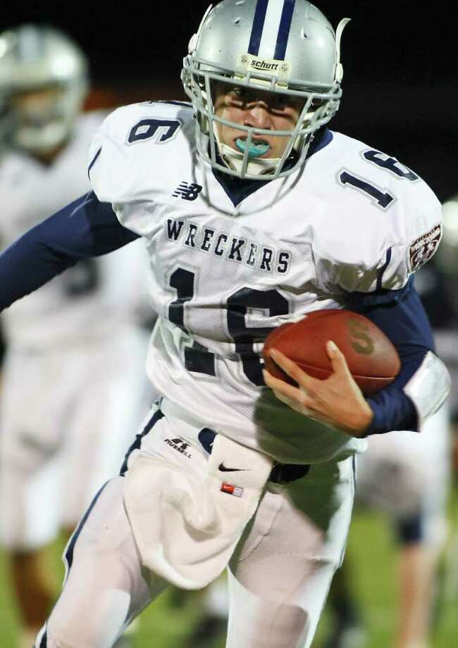 Jack Massie advances the ball for the Wreckers during Friday nights game against Wilton under the lights on November 5th. Photo: David E. Johnston / Connecticut Post Freelance