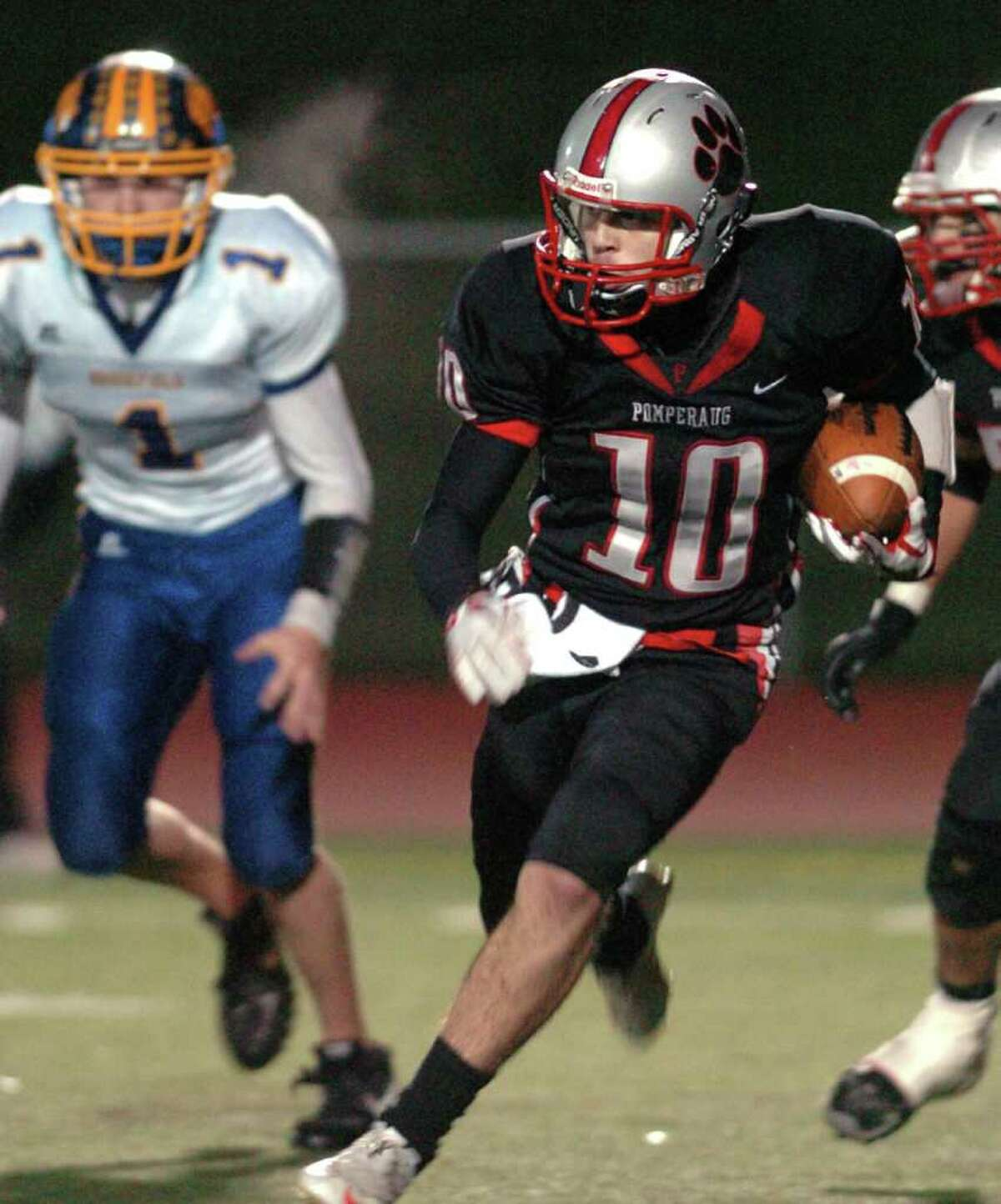 Pomperaug's 10, Connor O'dea heads upfield during the football game against Brookfield at Southbury High School Nov. 5, 2010.