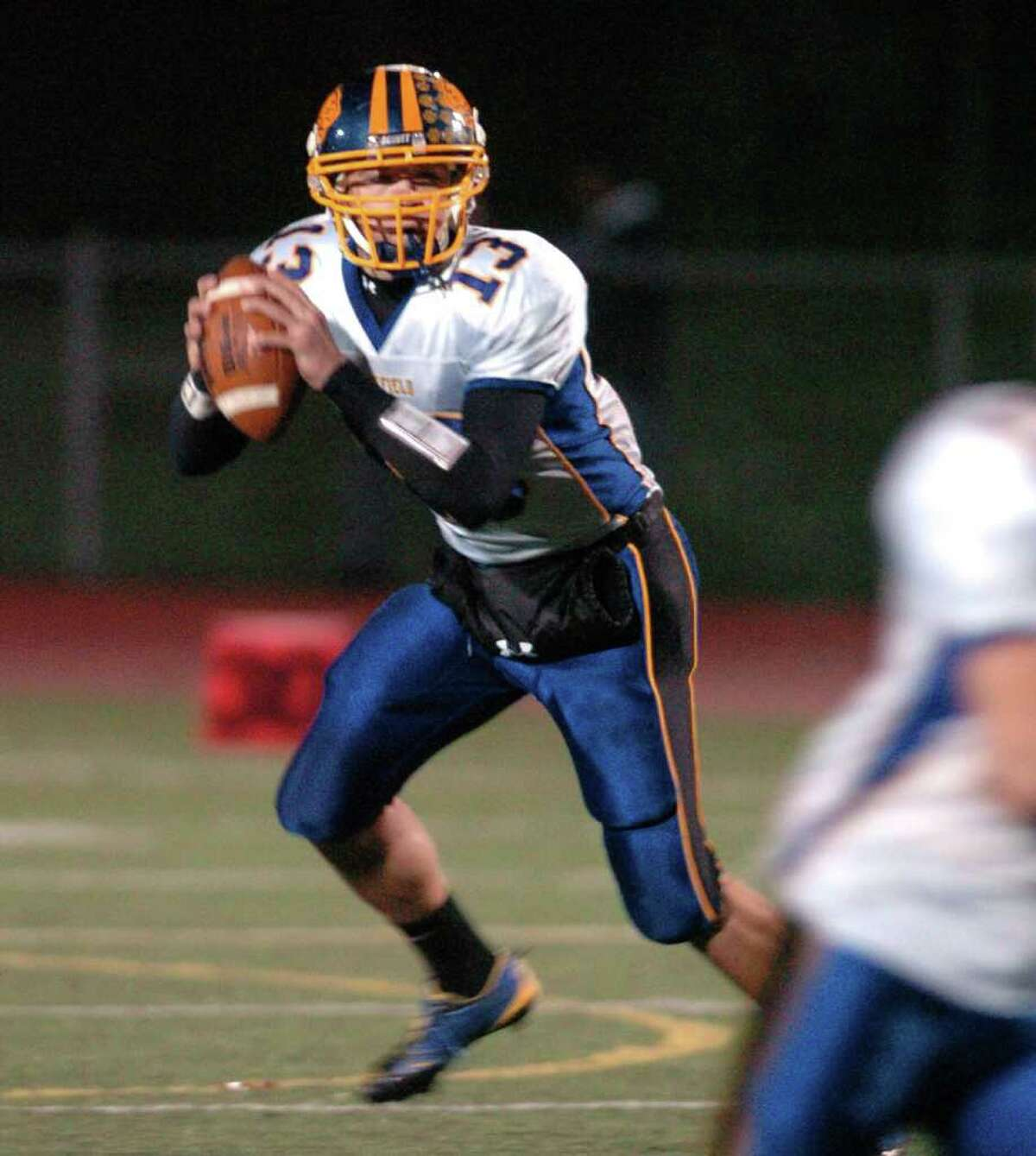 Brookfield's 13, Boeing Brown sets up for a pass during the football game against Pomperaug at Southbury High School Nov. 5, 2010.