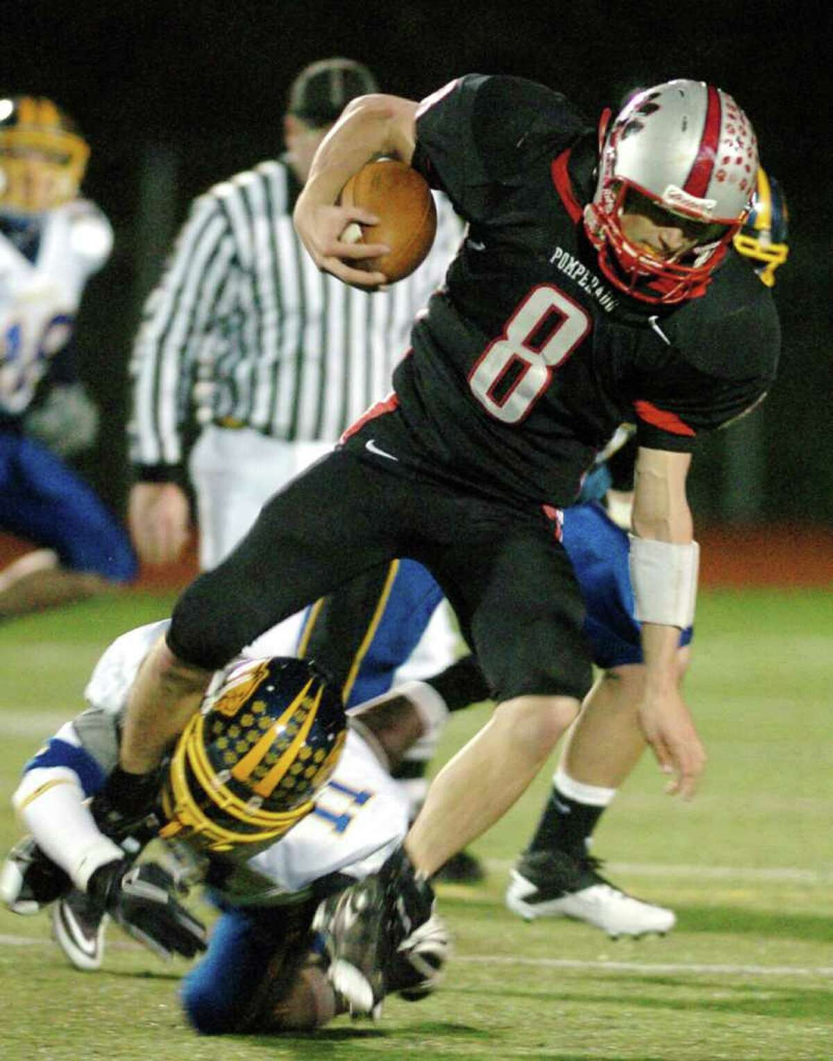 Pomperaug's 8, Andrew Reel, is tackled by Brookfield's 11, Alphonso Gordon, during the football game at Southbury High School Nov. 5, 2010.