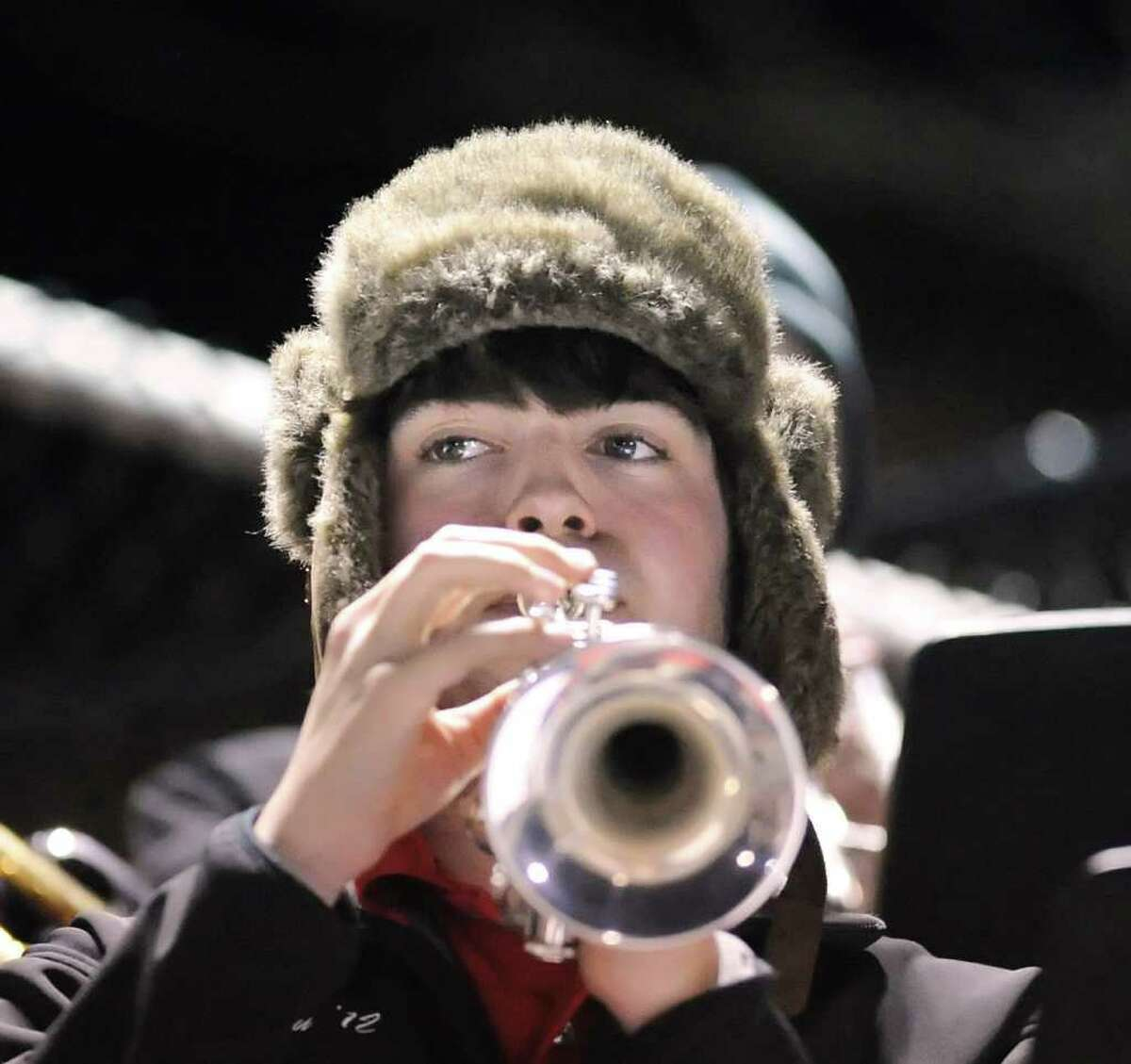 Ben Granath of the New Canaan High School pep band plays the trumpet during the High School football game between Greenwich High School vs. New Canaan High School at New Canaan High School, Friday night, Nov. 5, 2010.