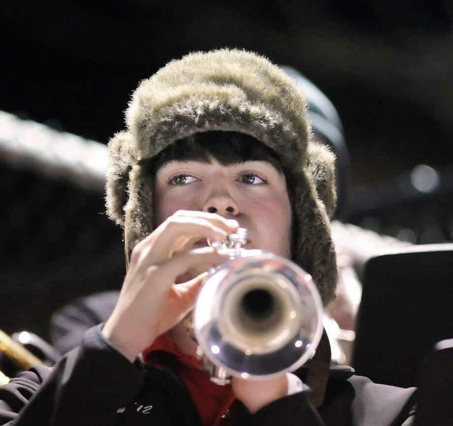 Ben Granath of the New Canaan High School pep band plays the trumpet during the  High School football game between Greenwich High School vs. New Canaan High School at New Canaan High School, Friday night, Nov. 5, 2010. Photo: Bob Luckey / Greenwich Time