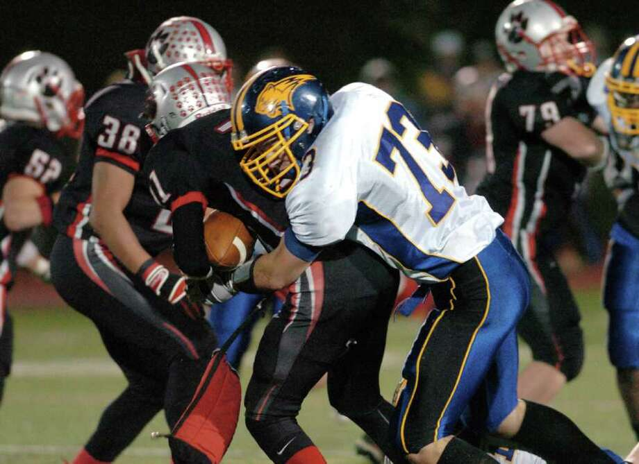 Brookfield's 73, Joel Wamser tackles Pomperaug during the football game at Southbury High School Nov. 5, 2010. Photo: Chris Ware / The News-Times