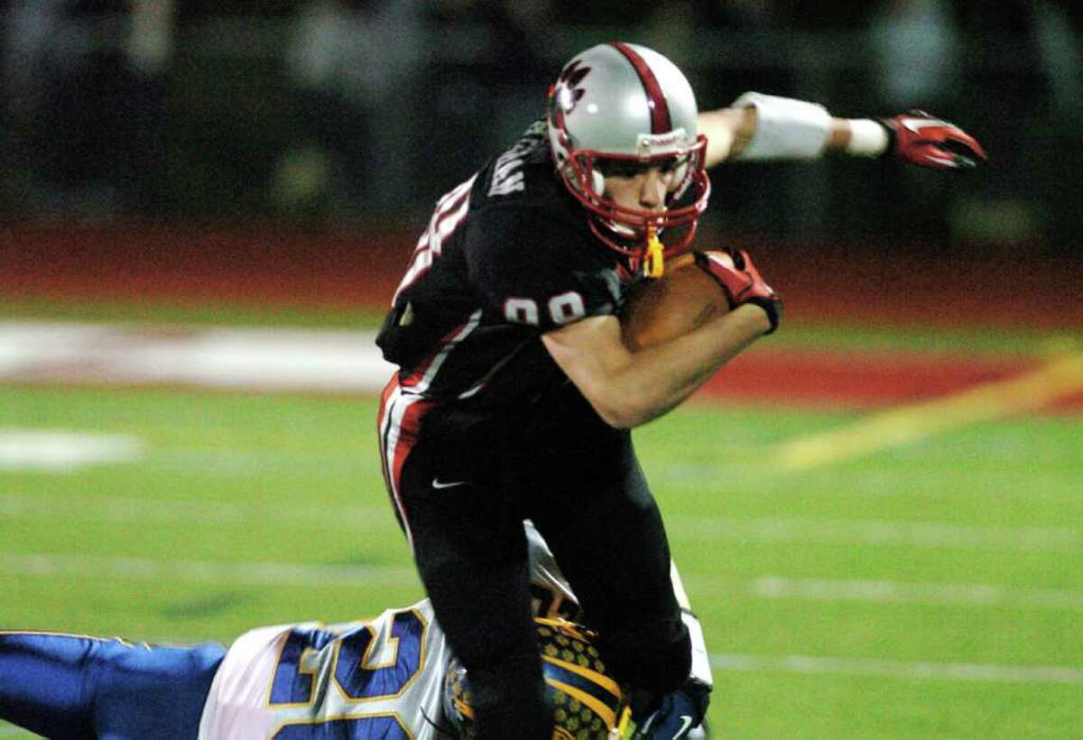 Pomperaug's 88, Brett Gaughan is tackled by Brookfield during the football game at Southbury High School Nov. 5, 2010.