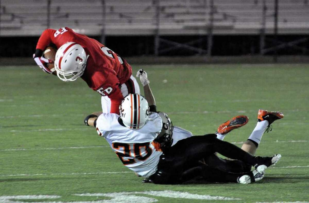 Fairfield Prep's Vinny McAvey is brought down by Shelton's Dan Guerrera and Michael Georgalas during the varsity football game at Fairfield University's Alumni Field on Friday, Nov. 5, 2010.
