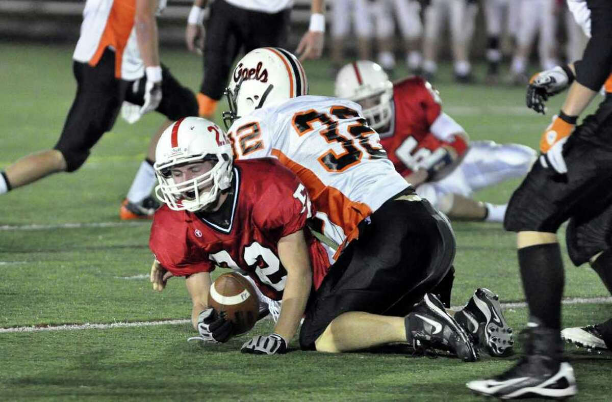 Fairfield Prep's Kyle Vignone is brought down by Shelton's Gary Thompson during the varsity football game at Fairfield University's Alumni Field on Friday, Nov. 5, 2010.