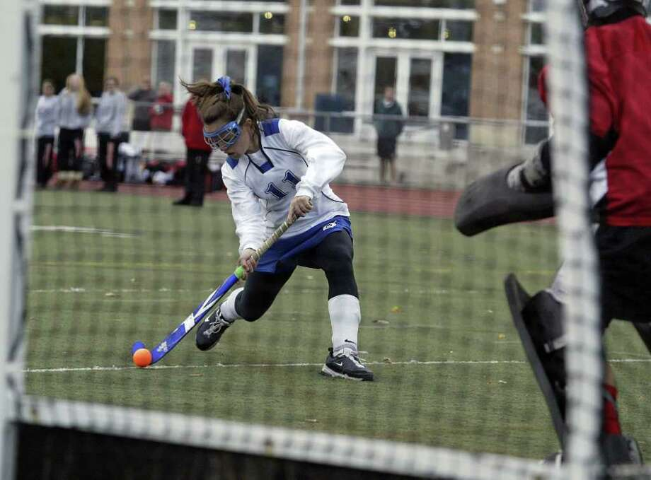 Darien High School field hockey player Madeline Gill  fires a shot on goal for a Darien score during the Blue Waves 4-0 FCIAC win over Fairfield Warde on Friday afternoon. The Blue won won the FCIAC title for the fourth time. 11/5/10 Photo: J. Gregory Raymond / J. Gregory Raymond for The Stamford Advocate Freelance