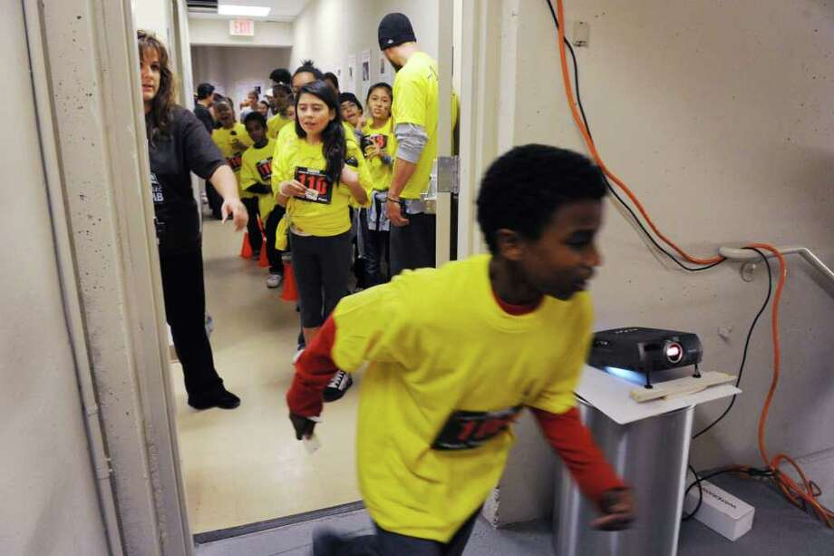 "A group Stamford students from the Domus Foundation wait to hit the start line as they participate in the ""Fight for Air"" Climb to benefit the American Lung Association at Trump Parc in Stamford, Conn. on Saturday November 6, 2010. Photo: Kathleen O'Rourke / Stamford Advocate"