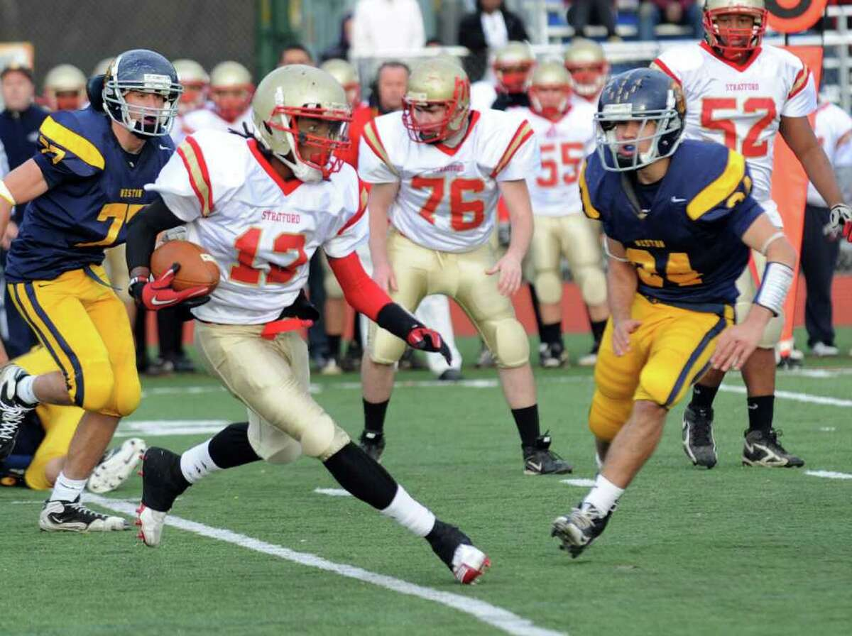 Stratford's QB Markey Desruisseaux, left, carries the ball, during football action against Weston in Weston, Conn. on Saturday November 6, 2010.